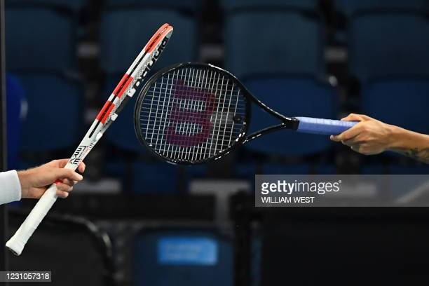 Britain's Cameron Norrie touches racquets with Britain's Daniel Evans after their men's singles match on day two of the Australian Open tennis...