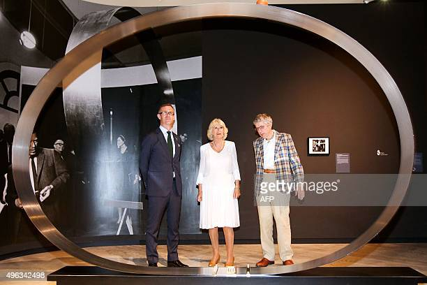 Britain's Camilla Duchess of Cornwall admires a Len Lye sculpture with Director of GovettBrewster Gallery and Len Lye Centre Simon Rees and Len Lye...