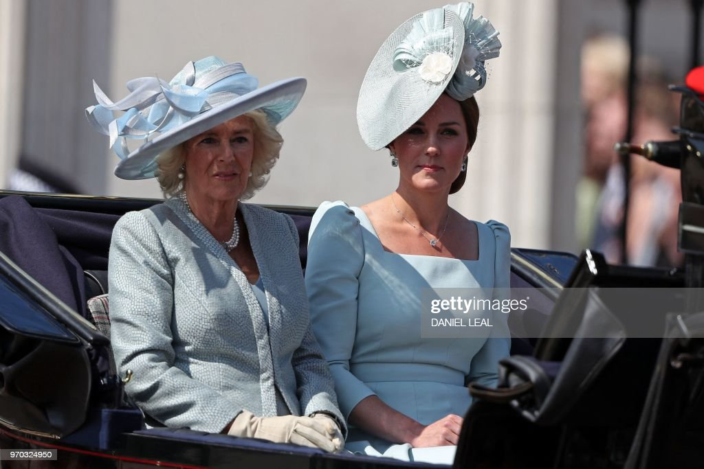 TOPSHOT - Britain's Camilla, Duchess of Cornwall (L) and Britain's Catherine, Duchess of Cambridge, travel in a carriage to Horseguards parade ahead of the Queen's Birthday Parade, 'Trooping the Colour', in London on June 9, 2018. - The ceremony of Trooping the Colour is believed to have first been performed during the reign of King Charles II. In 1748, it was decided that the parade would be used to mark the official birthday of the Sovereign. More than 600 guardsmen and cavalry make up the parade, a celebration of the Sovereign's official birthday, although the Queen's actual birthday is on 21 April.