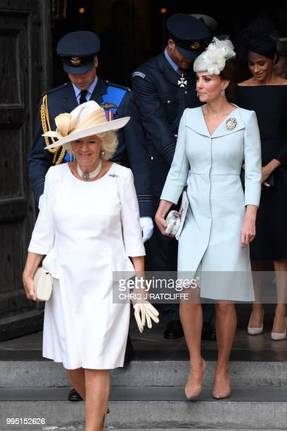 Britain's Camilla Duchess of Cornwall and Britain's Catherine Duchess of Cambridge leave a service to mark the centenary of the Royal Air Force at...
