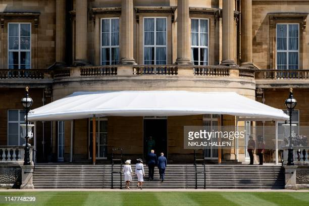 Britain's Camilla Duchess of Cornwall and Britain's Prince Charles Prince of Wales greet US President Donald Trump and US First Lady Melania Trump on...