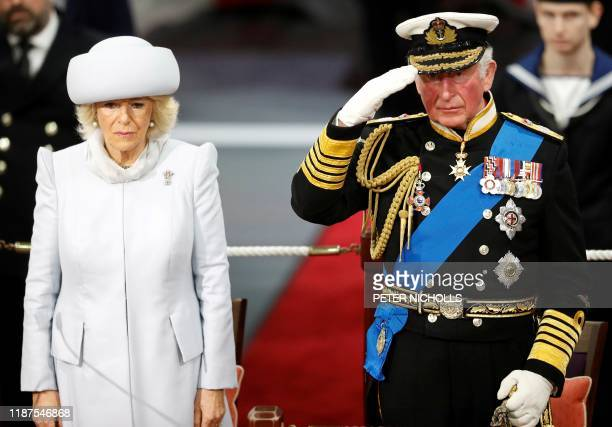 Britain's Camilla, Duchess of Cornwall and Britain's Prince Charles, Prince of Wales attend the official commissioning ceremony of HMS Prince of...