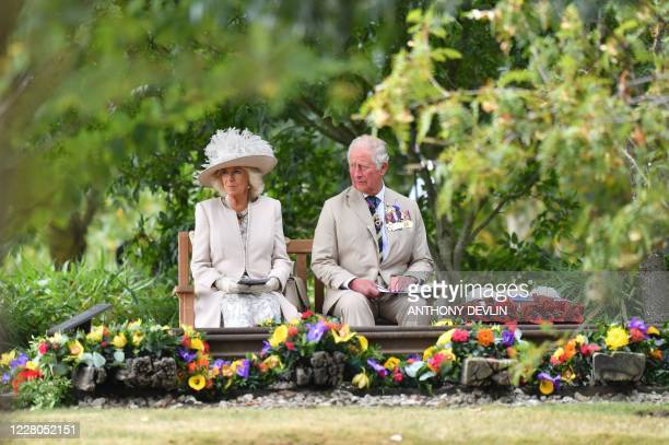 TOPSHOT Britain's Camilla Duchess of Cornwall and Britain's Prince Charles Prince of Wales attend a national service of remembrance at the National...