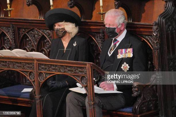 Britain's Camilla, Duchess of Cornwall and Britain's Prince Charles, Prince of Wales sit during the funeral service of Britain's Prince Philip, Duke...