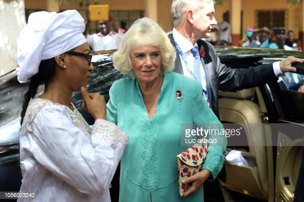 Britain's Camilla , Duchess of Cornwall, and Fatou Bah-Barrow , wife of Gambia's President Adama Barrow, arrive to visit the Saint Theresa's school...