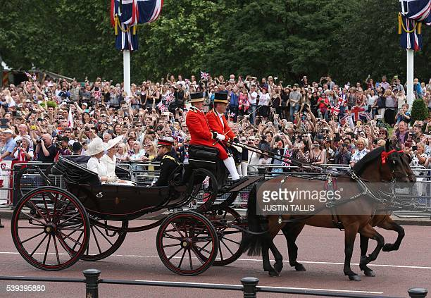 Britain's Camilla Duchess of Cornwall Britain's Catherine Duchess of Cambridge and Britain's Prince Harry travel in a horsedrawn carriage to...