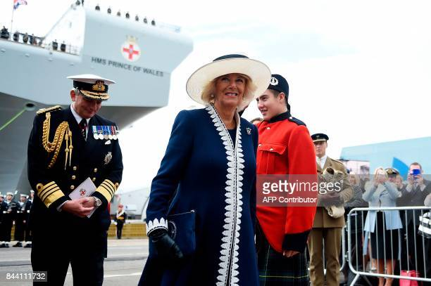 Britain's Camilla Duchess of Cornwall Duchess of Rothesay in Scotland arrives to attend the official naming ceremony of the QE Class aircraft carrier...