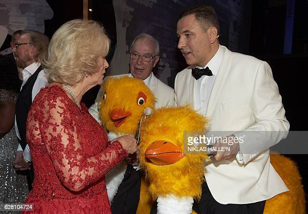 Britain's Camilla Duchess of Cornwall greets comedian David Walliams following the Royal Variety Performance at the Hammersmith Apollo in London on...