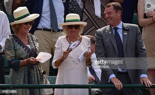 Britain's Camilla Duchess of Cornwall holds the sweatband of Britain's Andy Murray after Murray threw it into the crowd and a spectator handed it to...