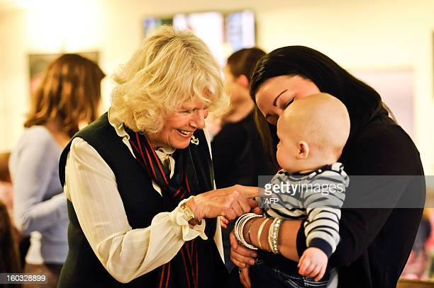Britain's Camilla Duchess of Cornwall meets baby Corey Wilmott 6 months old and his mum Natalie whose husband Sergeant Gavin Wilmott is serving with...