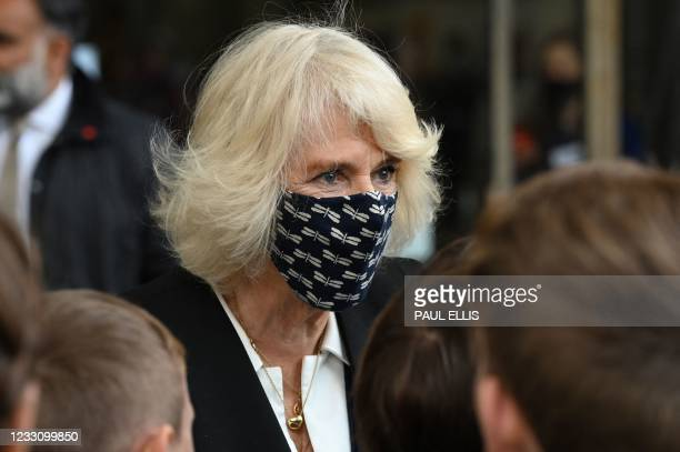 Britain's Camilla, Duchess of Cornwall meets school children during a visit to Coventry Cathedral in Coventry, central England on May 25 during the...
