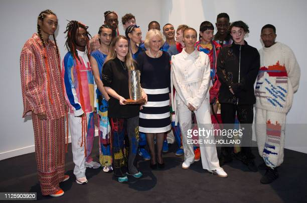 Britain's Camilla Duchess of Cornwall poses for a photograph with designer Bethany Williams holding the Queen Elizabeth ll Award for British Design...