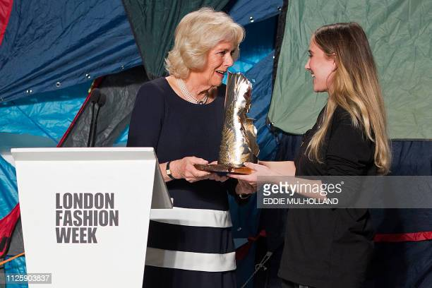 Britain's Camilla Duchess of Cornwall presents the Queen Elizabeth ll Award for British Design to designer Bethany Williams during her visit to...