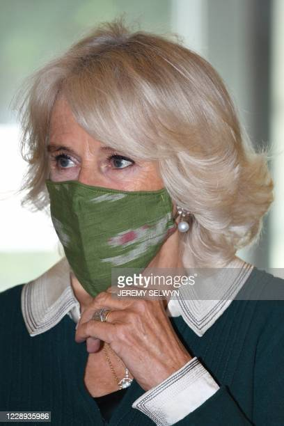 Britain's Camilla Duchess of Cornwall President of Maggie's wears a facemask during her visit to Maggie's Barts at St Bartholomew's Hospital in...