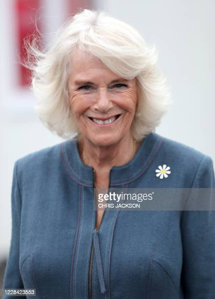 Britain's Camilla Duchess of Cornwall reacts during her visit to Medical Detection Dogs' training facility in Milton Keynes north of London on...