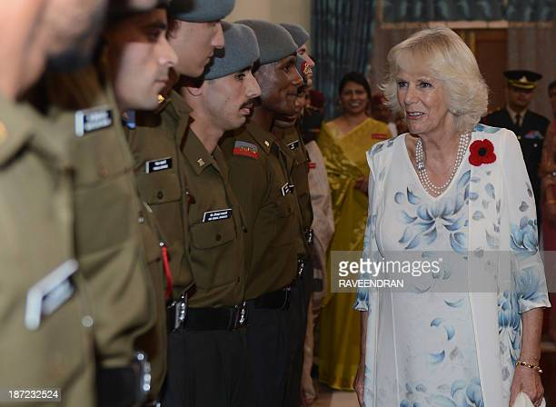 Britain's Camilla Duchess of Cornwall shares a light moment with junior Indian Army officers during a visit to The Indian Military Academy in...