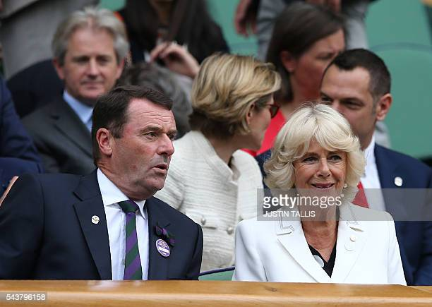 Britain's Camilla Duchess of Cornwall sits in the Royal box on centre court to watch Japan's Kei Nishikori and France's Julien Benneteau during their...