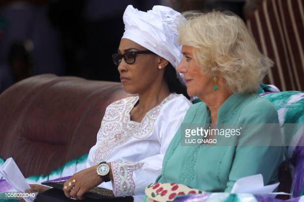 Britain's Camilla , Duchess of Cornwall, sits next to Fatou Bah-Barrow, wife of Gambia's President Adama Barrow, during their visit at the Saint...