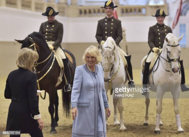 Britain's Camilla Duchess of Cornwall stands next to the General Manager of the Spanish Riding School Elisabeth Guertler during a visit at the...
