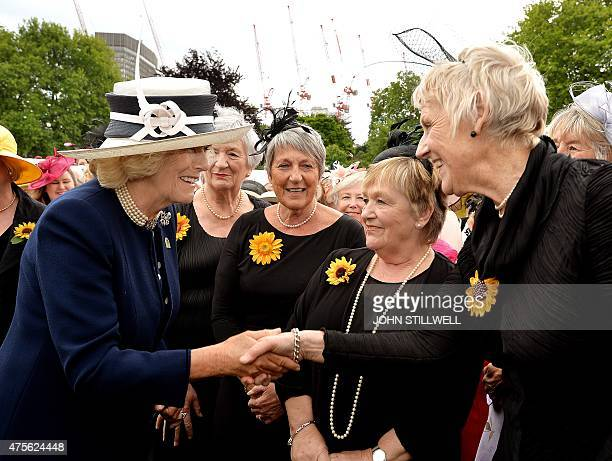 Britain's Camilla Duchess of Cornwall talks with the Calender Girls a group of women who posed for a nude calendar to raise funds for Leukaemia...