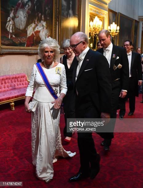 Britain's Camilla, Duchess of Cornwall walks with US Ambassador to the UK Woody Johnson , Britain's Prime Minister Theresa May and Britain's Prince...