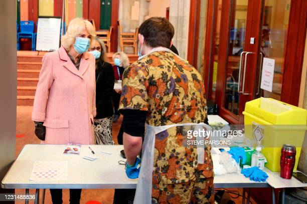 Britain's Camilla, Duchess of Cornwall wearing a protective face covering to combat the spread of the coronavirus, visits the Community Vaccination...