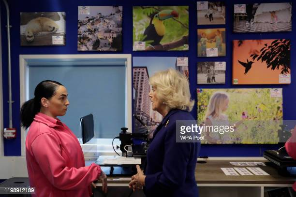 Britain's Camilla, the Duchess of Cornwall speaks with Marsida, a prisoner, being trained in the Max Spielmann Academy, an onsite shop where inmates...