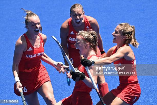 Britain's captain Hollie Pearne-Webb celebrates with teammates after scoring against India during the women's bronze medal match of the Tokyo 2020...