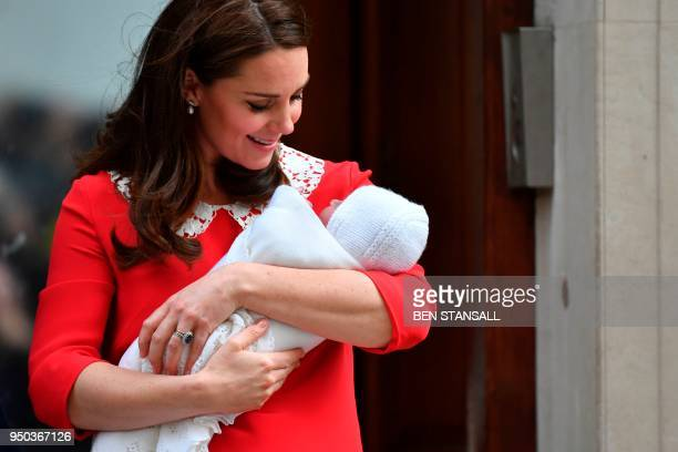 TOPSHOT Britain's Catherine Duchess of Cambridge looks at her newlyborn son her third child on the steps of the Lindo Wing at St Mary's Hospital in...