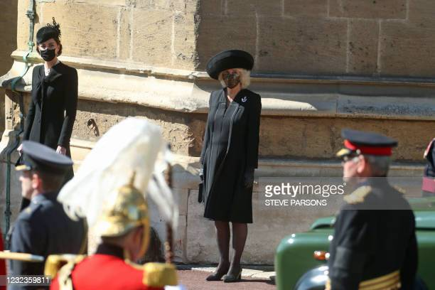 Britain's Catherine, Duchess of Cambridge and Britain's Camilla, Duchess of Cornwall watch the ceremonial funeral procession of Britain's Prince...