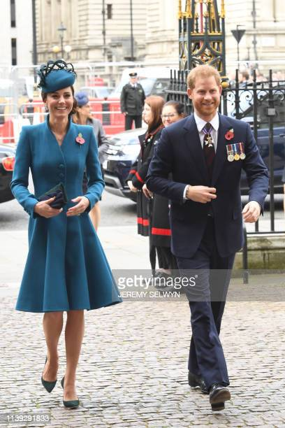 Britain's Catherine, Duchess of Cambridge, and Britain's Prince Harry, Duke of Sussex, arrive to attend a service of commemoration and thanksgiving...