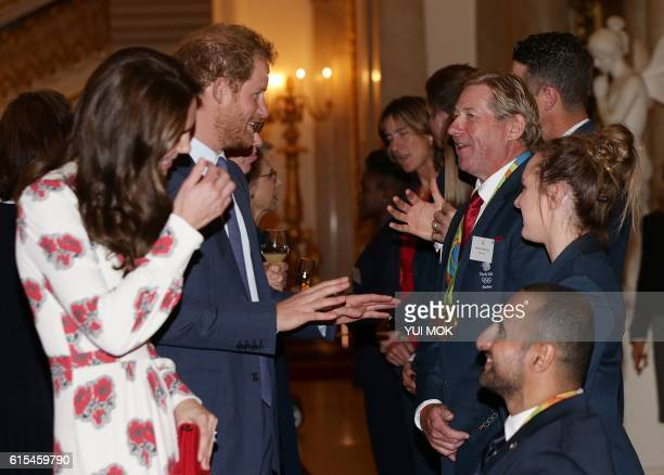 Britain's Catherine Duchess of Cambridge and Britain's Prince Harry meet athletes Nick Skelton and Ali Jawad during a reception for Team GB's Olympic...