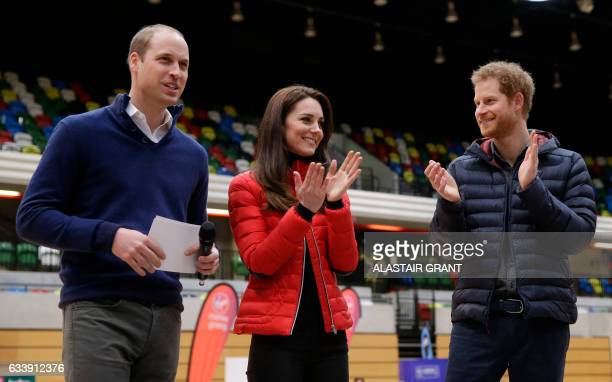 Britain's Catherine Duchess of Cambridge and Britain's Prince Harry applaud Britain's Prince William Duke of Cambridge after he spoke during a...