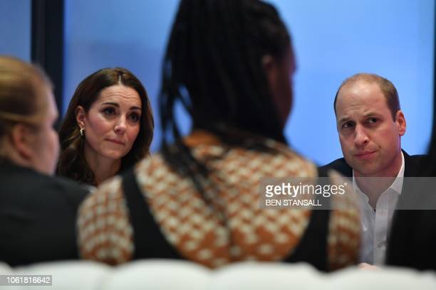 Britain's Catherine Duchess of Cambridge and Britain's Prince William Duke of Cambridge talk with young people about online bullying during a visit...