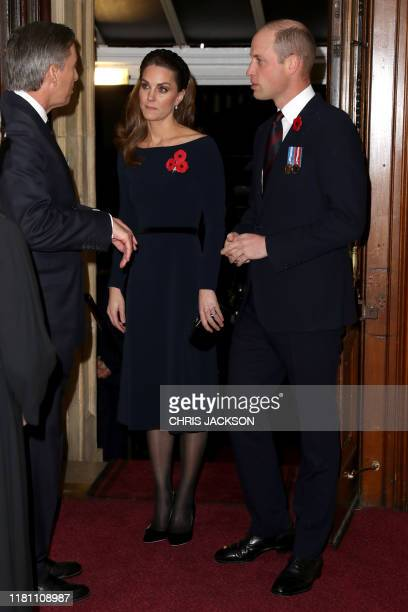 Britain's Catherine Duchess of Cambridge and Britain's Prince William Duke of Cambridge arrive to attend the annual Royal British Legion Festival of...