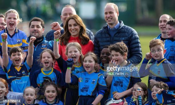 Britain's Catherine, Duchess of Cambridge and Britain's Prince William, Duke of Cambridg pose for a photograph during a visit to Salthill Gaelic...