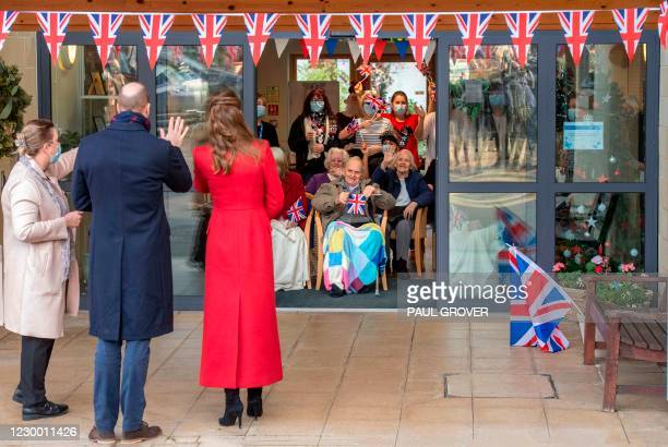 Britain's Catherine, Duchess of Cambridge and Britain's Prince William, Duke of Cambridge , speak with residents on a visit Cleve Court Care Home in...