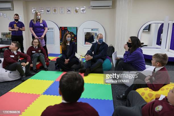 Britain's Catherine, Duchess of Cambridge and Britain's Prince William, Duke of Cambridge join a group of local school children from Loxdale Primary...