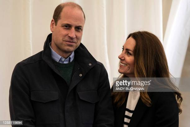 Britain's Catherine, Duchess of Cambridge and Britain's Prince William, Duke of Cambridge meet students as they visit the University of St Andrews in...