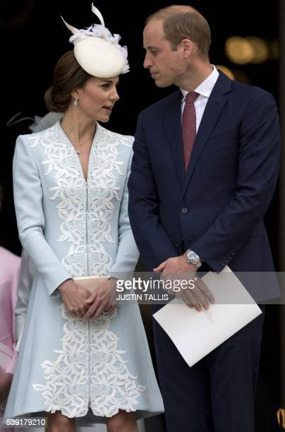 Britain's Catherine, Duchess of Cambridge and Britain's Prince William, Duke of Cambridge leave after attending a national service of thanksgiving...