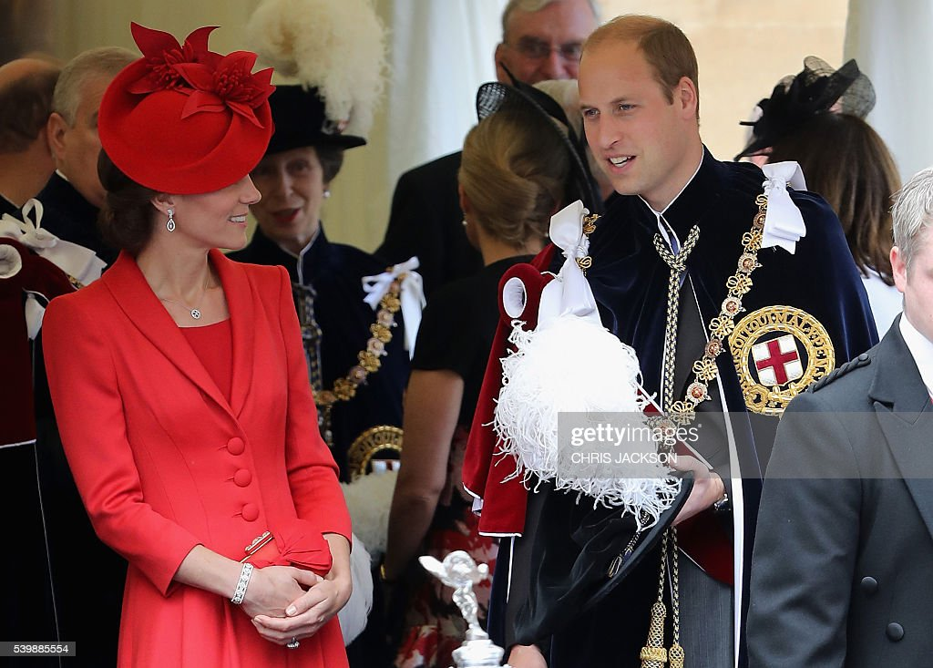 Britain's Catherine, Duchess of Cambridge (L) and Britain's Prince William, Duke of Cambridge, talk as they wait for cars to pick them up to leave after attending the Most Noble Order of the Garter Ceremony at St George's Chapel, Windsor Castle in Windsor, west of London on June 13, 2016. The Order of the Garter is the oldest and most senior Order of Chivalry in Britain, established by King Edward III nearly 700 years ago. / AFP / POOL / CHRIS