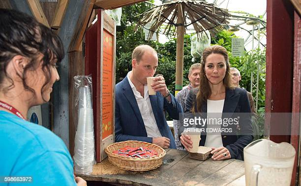 Britain's Catherine Duchess of Cambridge and Britain's Prince William Duke of Cambridge sample a cup of baobab a tropical Malawian fruit drink in the...