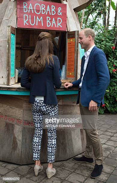 Britain's Catherine Duchess of Cambridge and Britain's Prince William Duke of Cambridge order a cup of baobab a tropical Malawian fruit drink in the...