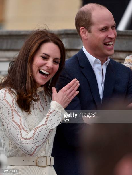 Britain's Catherine Duchess of Cambridge and Britain's Prince William Duke of Cambridge laugh as they host a Special Garden Party at Buckingham...