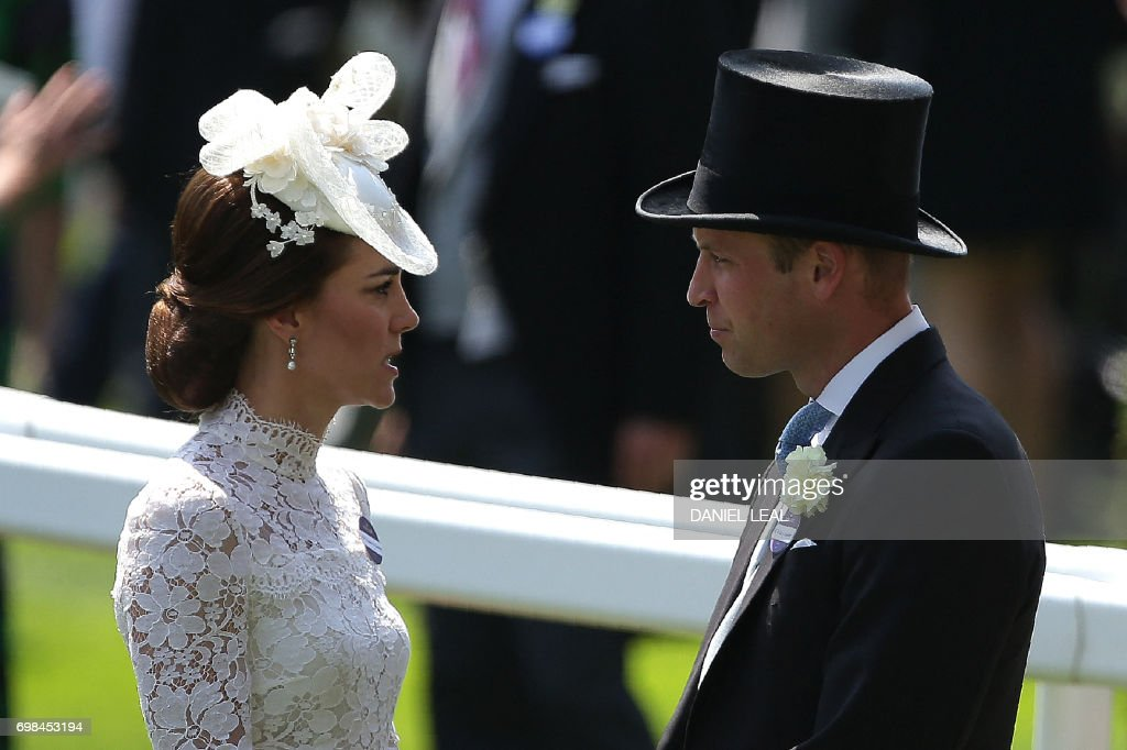 TOPSHOT - Britain's Catherine, Duchess of Cambridge (L) and Britain's Prince William, Duke of Cambridge, attend day one of the Royal Ascot horse racing meet, in Ascot, west of London, on June 20, 2017. The five-day meeting is one of the highlights of the horse racing calendar. Horse racing has been held at the famous Berkshire course since 1711 and tradition is a hallmark of the meeting. Top hats and tails remain compulsory in parts of the course while a daily procession of horse-drawn carriages brings the Queen to the course. / AFP PHOTO / Daniel LEAL