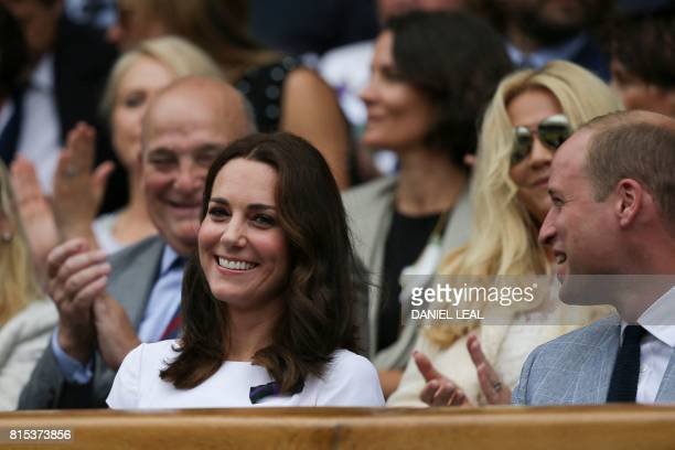 Britain's Catherine Duchess of Cambridge and Britain's Prince William Duke of Cambridge in the Royal box on Centre Court for the men's singles final...