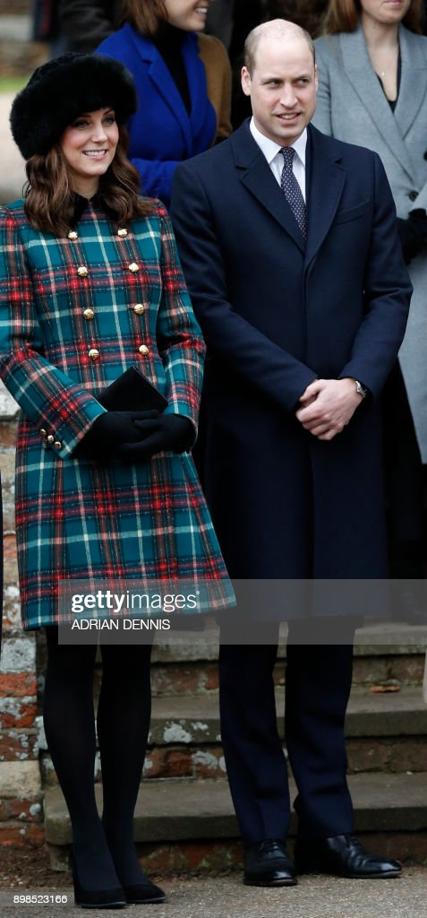 Britain's Catherine, Duchess of Cambridge, (L) and Britain's Prince William, Duke of Cambridge, (R) stand together as they wait to see off Britain's Queen Elizabeth II after attending the Royal Family's traditional Christmas Day church service at St Mary Magdalene Church in Sandringham, Norfolk, eastern England, on December 25, 2017. / AFP PHOTO / Adrian DENNIS