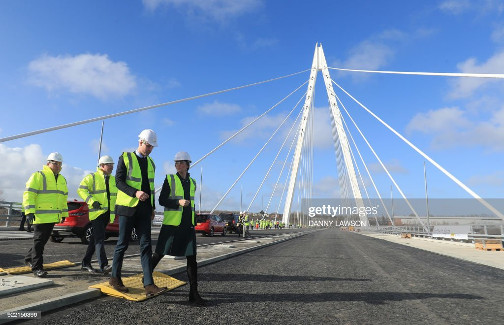 Britain's Catherine, Duchess of Cambridge, (R) and Britain's Prince William, Duke of Cambridge, (2R) visit the under-construction Northern Spire Bridge across the River Wear in Sunderland on February 21, 2018. The Duke and Duchess of Cambridge visited Sunderland to learn about the city's arts scene and engineering talent. Construction began on the three span cable-stayed structure bridge over the River Wear in Sunderland in May 2015. / AFP PHOTO / POOL / Danny Lawson