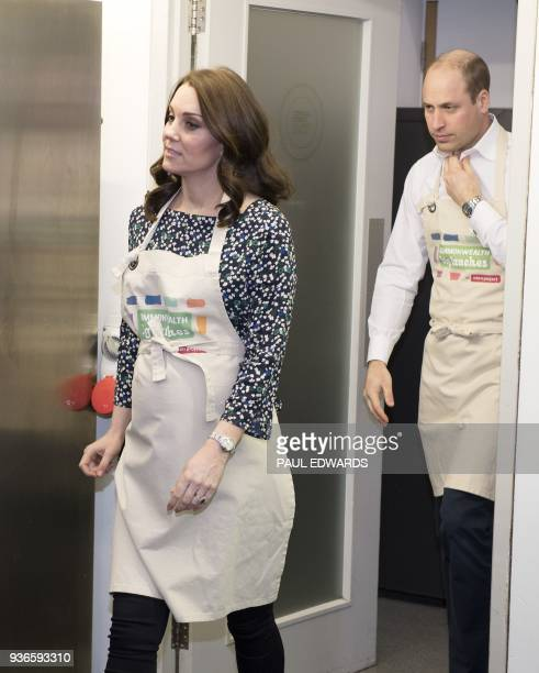 Britain's Catherine Duchess of Cambridge and Britain's Prince William Duke of Cambridge take part in preparations for a Commonwealth Big Lunch at St...