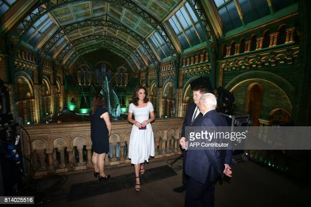 Britain's Catherine Duchess of Cambridge and David Attenborough are shown a blue whale skeleton by museum director Sir Michael Dixon during the...
